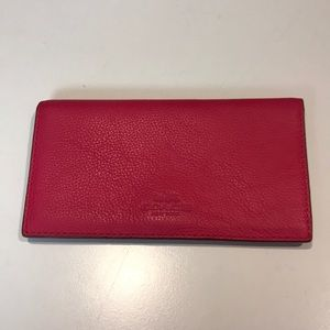 Pink COACH leather checkbook holder